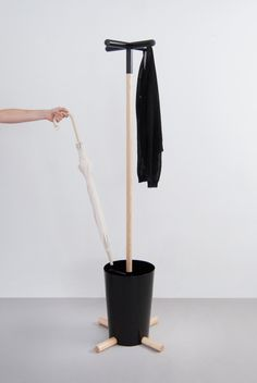 Plus Coat Stand, Visibility: made of wood, steel, and rubber; uses the iconography of the '+' and the 'o' signs; the horizontal '+' at the top uses rubber caps to keep garments on while the x counterpart on the bottom keeps the entire stand in place.