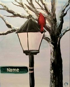 Street light and red cardinal in the middle of winter. Space for street name or family name.