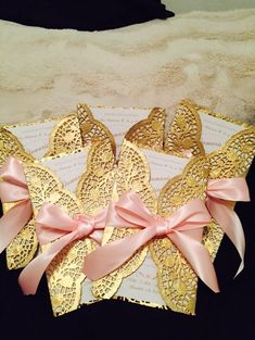 Doilies with gold spray paint and ribbons