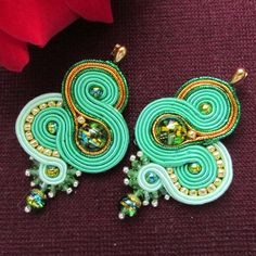 Hi! :) Welcome to JOKUart where you will find original soutache jewelry and copper wire art work. Available in my shop: necklaces and pendants, bracelets, earrings, hair accessories. If You want to see more photos, please visit my shop. :)
