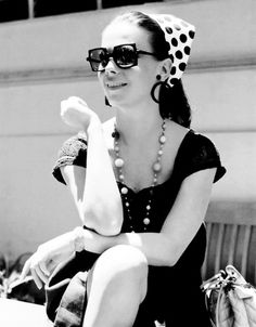 Headscarf, sunglasses, necklace-accessorizing with Natalie Wood....