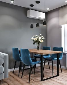Modern dining area with blue velvet chairs. Love the minimalistic light fixtures Modern dining area with blue velvet chairs. Love the minimalistic light fixtures The decoration of our home is much like. Interior Design Living Room Warm, Dining Room Design, Interior Design Kitchen, Interior Decorating, Dining Area, Decorating Ideas, Esstisch Design, Kitchen Cabinet Colors, Room Decor