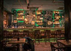 STEAMPUNK STYLE: commercial #interior with a stunning steampunk bar #design and green #lighting
