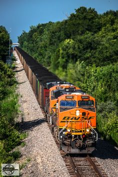 Eastbound BNSF Loaded Coal Train at Richmond, MO | Running up the BNSF Brookfield Sub. right on a grain empty's trail is Thomas Hill load BNSF Train C NAMTHH 114A topping the grade at Million Dollar Cut on the old CB&Q Centennial Cutoff. On the rear end are BNSF 9578 and CREX 1314 as DPU's. Locomotives: BNSF 6050, BNSF 6183 7-9-17 Richmond, MO