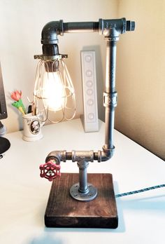 Custom pipe lamp where I turned the faucet into a switch.