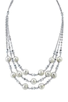 Triple 9mm White Ringed Freshwater Pearl & Crystal Necklace This is really pretty but I really like pearls.