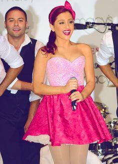 Ariana Grande in a cute mini dress at a concert.