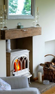 Wood burning stove with rustic wood mantle~ (outside wood stove articles) Oak Beam Fireplace, Wood Mantle, Stove Fireplace, Fireplace Inserts, Fake Mantle, Wood Stove Hearth, Craftsman Fireplace, Natural Curtains, Furniture