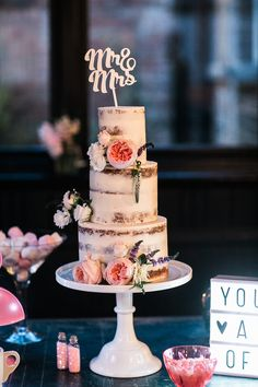 Semi-naked wedding cake by Blossom and Crumb. Photo by Samie lee Photography.