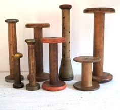 Wooden bobbins...so many varieties of shapes and sizes! Would love to find some that still had thread on them!