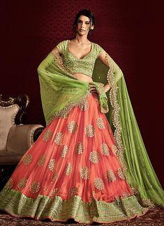 Women s Clothing - Wedding Wear Peach & Green Net Lehenga Choli - 5056 - PRODUCT Details : Style : Semi-Stitched Party Wear / Wedding Wear Lehenga CholiDefault Size Lehenga Choli Designs, Ghagra Choli, Pakistani Dresses, Indian Dresses, Indian Outfits, Eid Outfits, Eid Dresses, Indian Lehenga, Net Lehenga