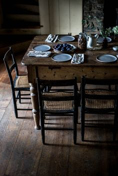 Love the floors, table, chairs with black and woven cane seats. Local Milk, Farmhouse Table, Farmhouse Interior, Rustic Table, Vintage Table, Dining Area, Dining Room, Country Decor, Country Living