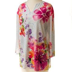 This Watercolor Tunic is more than just a great summer top, it's a work of art! The bold floral motif and tiny sparkling stones are something to be admired.