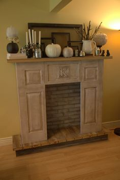 DIY Faux Fireplace, I really like this idea! I would paint the inside black though, and perhaps some cheap crown moulding from Lowes for the mantle top, if you don't want it to be this tall, I saw someone make it with just cabinet doors (4 large and 2 small)  Also maybe a coffee table top for the hearth? Cut the legs off and paint it to match.