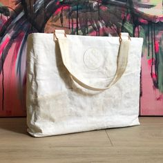 ScobyTec business hand bag made from biofabricated purified, white, and smooth ScobyTec BNC material. The bag has compartments to store tablets and smartphones. Deep Learning, Futurism, Carbon Footprint, Laser Engraving, Bag Making, Sustainable Fashion, Cruelty Free, Vegan Leather, Patches
