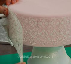 A delicate stenciled cake side by Global Sugar Arts
