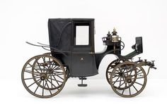 Landaulette carriage, 1885. This small carriage, well-suited for city traffic, was used with an open roof in good weather. Only the green paint with delicate gilt edging and the crowns on the lanterns and carriage door indicate that this coupé was a court vehicle. The carriage was build for Empress Elisabeth of Austria, who took it on journeys with her and used it for the last time before her assassination in Geneva. Imperial Carriage Museum of Vienna.