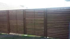 This a fence made from horizontal merbau decking on black powder coated steel posts. Merbau Decking, Timber Fencing, Diy Fence, Powder Coating, Modern Design, Fence Posts, Contemporary, Steel, Fences