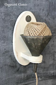 My twine holder is made from a funnel and a thrift shop, dated candle holder! t