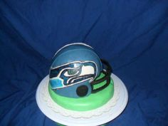 Seahawks Groom's Cake. Cake decorated in fondant.