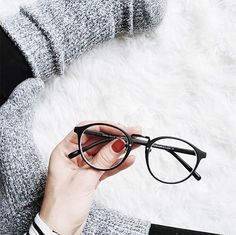 Sexy smart, meet cozy chic. We've created a pair of glasses that's somehow modestly flashy. Its simple matte black frame accented with a silver nose bridge adds just the right bit of pizazz. Come discover this playfully shy style for yourself.