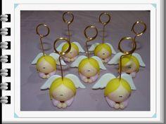 http://articulo.mercadolibre.com.ar/MLA-595005126-souvenirs-bautismo-portafotos-angelitos-con-iman-porc-fria-_JM