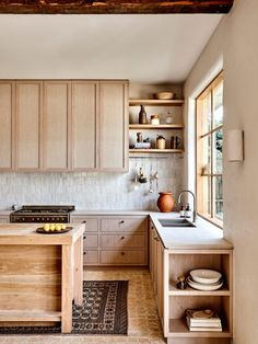Room of the Week :: Warm Woods & Old World Accents In this Minimal Kitchen - coco kelley - - This warm wood kitchen, punctuated by Moroccan tile and accents, brings so much inspiration in the way of details like plaster walls and open shelf styling. Cute Kitchen, Rustic Kitchen, Kitchen Decor, Kitchen Ideas, Wooden Kitchen, Pig Kitchen, Warm Kitchen, Decorating Kitchen, Kitchen White