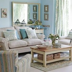 something soothing about calm blue walls in the living room  (perhaps Sherwin Williams Tradewind #6218?)