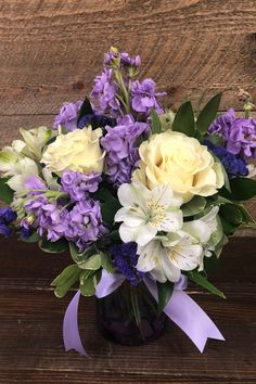 This stunning bouquet creates a beautiful splash of color, creating a gift of floral style and design your recipient will always remember. Blending lavender stock, stunning roses, statice, and alstroemeria and presented in a lavender clear glass vase, this is a perfect bouquet for any occasion!!