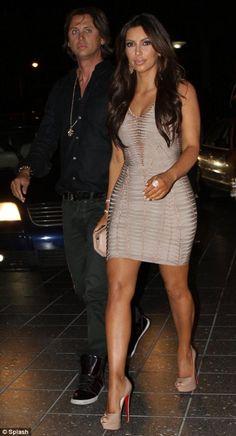 Kim Kardashian wearing HERVE LEGER MULTIFACETED OVAL CLUTCH IN BLUSH PINK Christian Louboutin Lady Peep Pumps in Nude Loren Jewels Earrings