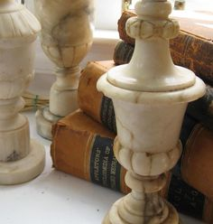 I LOVE LOVE LOVE Alabaster Vintage Lamps... easy to rewire yourself with a kit from home depot and then have a sexy oversized shade made for them... I like black shades with silver leaf lining