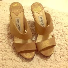 Jimmy Choo wooden sandal 4.5 inch heel. Gold metallic leather. Wooden heel. Excellent condition. Jimmy Choo Shoes
