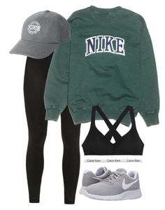 Wear sports bra, Wolfpack sweater, black leggings, sneakers, baseball cap.
