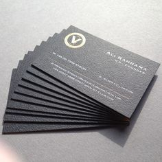 Stunning textured 600gsm business cards duplexed with debossed gold crest & white foil using brass dies with a gold foil edge.