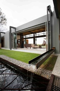 Each of the living areas of this modern house as well as one of the ...