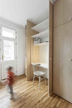A Family Apartment in Prague That's Filled With Clever Storage Solutions and Built-In Nooks - Photo 7 of 13 - Dwell