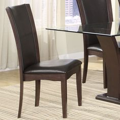 Daisy Dining Room Collection combines superb visual appearance and fine quality that you need in your dining area. Constructed of hardwood solids and cherry veneers in a high gloss espresso finish.