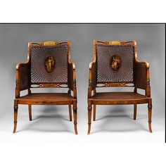 An rare pair of George III painted satinwood armchairs in the style of English Cabinet maker, George Seddon. The chairs feature inset caned backs with center medallions, double inset caned arms and caned seats. The stunning satinwood chair frames are painted in the neoclassical style introduced by the French 18th century Peintre ébénistes. This style was copied in England by the celebrated cabinetmaking firm of, George Seddon, Sons & Shackleton of Aldersgate Street, 1753 - 1868.