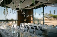 Hanging glass candle holders, drapery and flowers at Mallorca Wedding 2015, wedding planning and production by Undercover Events. Undercover Events, wedding & event planners in Mallorca.