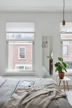 Textured naturals and green on white. Beautiful Dutch bedroom make-over. Holly Marder.