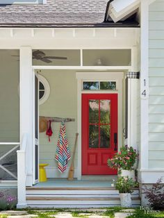 Help guests find your new digs. Paint your front door a standout hue. Hang noteworthy house numbers. Install arresting light fixtures. Edge walkways with solar lights. Pot up handsome containers with colorful plants and place them at the base of your steps.
