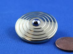 Fred the Spinning Coin Top by FocusWorks on Etsy