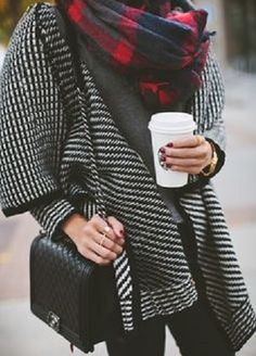 great black and white coat with red plaid scarf.. very casual style