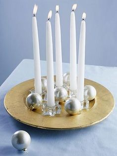 Easy Candle Display ~ Pressed for time? This arrangement takes just a few minutes to assemble. Insert taper candles in crystal candlesticks, arrange them on a platter, and add a few ornaments around the bases. Silver Christmas Decorations, Christmas Tablescapes, Christmas Candles, Christmas Centerpieces, Christmas Holidays, Christmas Displays, Xmas, Christmas Tea, Christmas Balls