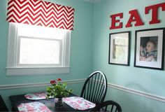 Cute breakfast nook. Love the pictures on the wall of the kids eating! The soft blue/green shade makes the red pop.