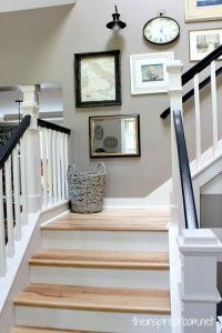 before and after stair makeover. Light floors, dark railing, white post