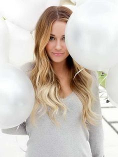 Blonde model with balloons photoshoot