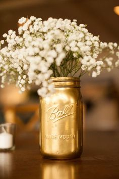 Looking for an affordable alternative for a wedding table centerpiece? Try DIY gold mason jar vases.