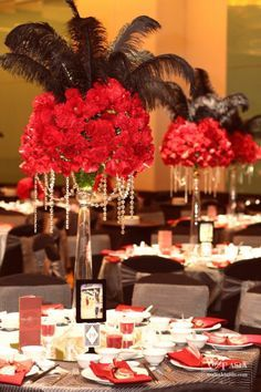 Elegant Feather and flower centerpiece for a black & red theme party