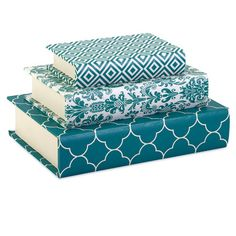 use wrapping paper or fabric pattern to cover books as decorations!!! great for entertainment center decor!